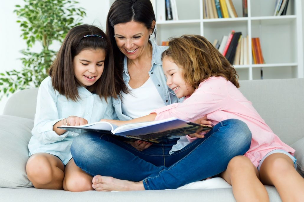 Mother and daughters reading together