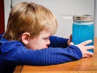 Toddler with Calming Jar