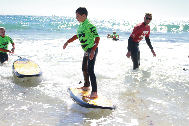 Have your child learn how to surf and swim at Jeffrey's Bay Surf School